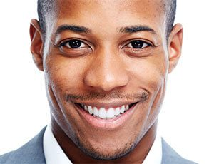 Smiling man with teeth whitening